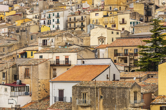 Italy, Sicily, Province of Palermo, Prizzi. View of homes and buildings in the ancient hill town of Prizzi.