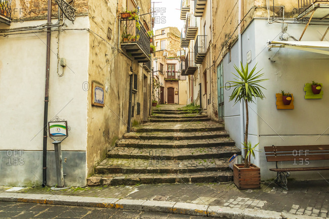 Italy, Sicily, Palermo Province, Castelbuono. Stairs on a narrow side street in the town of Castelbuono.