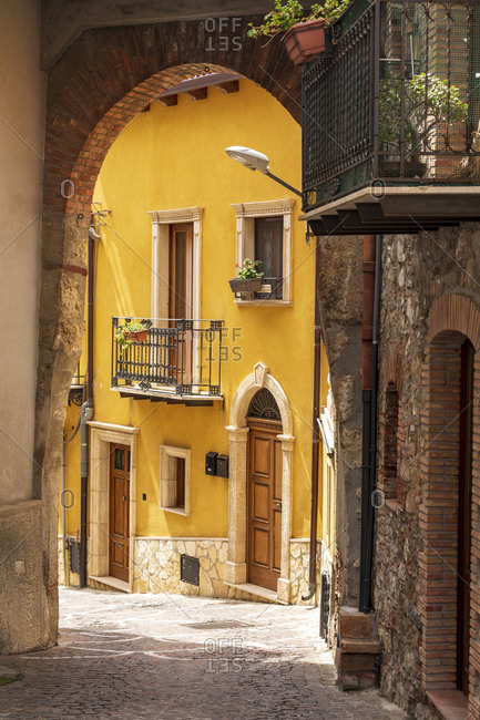Italy, Sicily, Messina Province, Caronia. An archway over a narrow cobblestone street in the medieval hill town of Caronia.