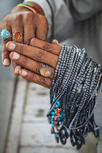 Africa, Egypt, Aswan. September 21, 2018. Hands of a male salesman, selling replicas of Onyx jewelry at a tourist site