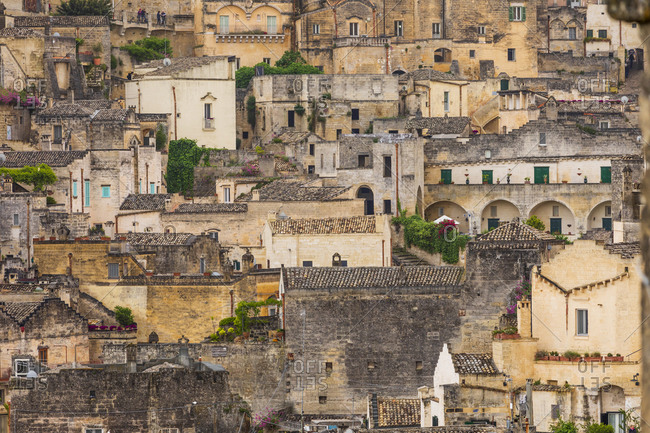 Italy, Basilicata, Province of Matera, Matera. Old stone buildings on a steep hillside.