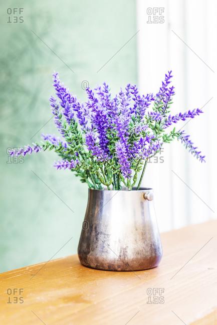 Italy, Apulia, Metropolitan City of Bari, Monopoli. Lavender flowers in a metal vase.