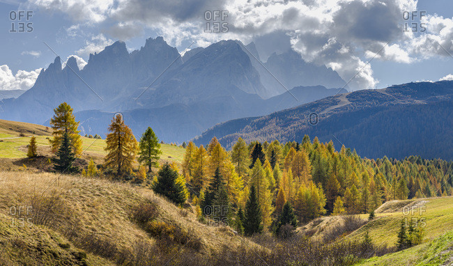 View towards Pale di San Martino, Focobon mountain range, in the Dolomites of Trentino, seen from alpe Fuciade in the southern Marmolada range. Italy.