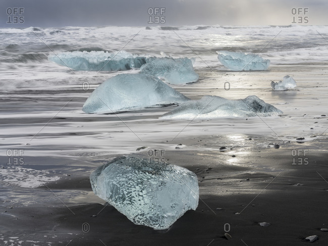 Icebergs on black volcanic beach, Iceland.
