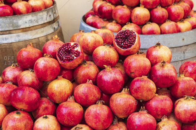 Italy, Sicily, Trapani Province, Trapani. Pomegranates for sale at the market in Trapani.