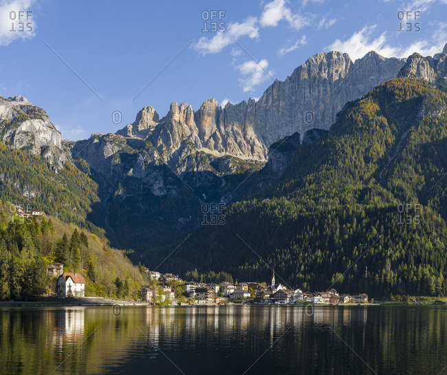 October 21, 2018: Alleghe at Lago di Alleghe under the peak of Civetta, an icon of the dolomites in the Veneto, Italy. Civetta is part of the UNESCO World Heritage Site.