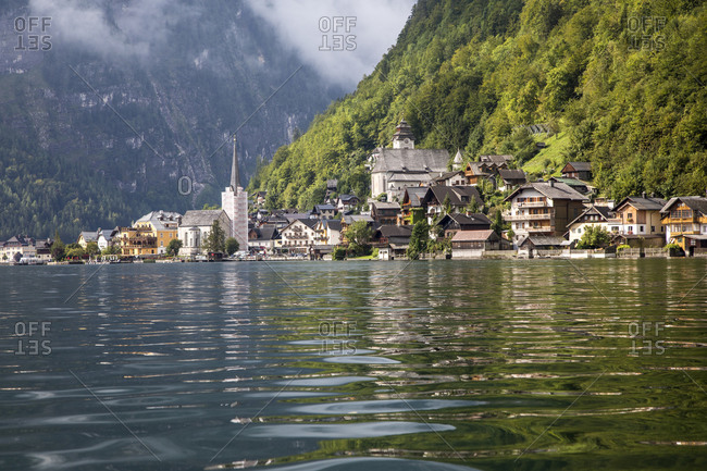 Europe, Austria, Hallstatt, Town of Hallstatt as seen from Lake Hallstatt which is part of the Salzkammergut Cultural Landscape, UNESCO World Heritage Site