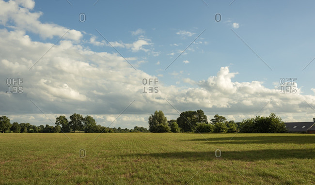 Beautiful country field on partially cloudy day