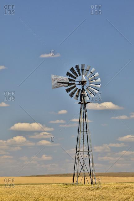 June 24, 2018: Windmill in wheat field Eastern Washington