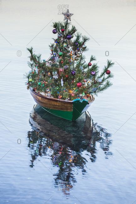 USA, Massachusetts, Nantucket Island. Nantucket Town, small dory with Christmas tree.
