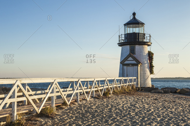 USA, Massachusetts, Nantucket Island. Nantucket Town, Brant Point Lighthouse with a Christmas wreath.