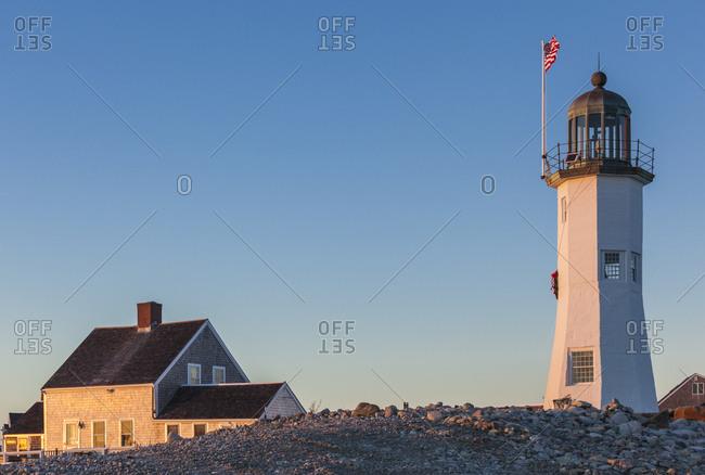 USA, Massachusetts, Scituate, Scituate Lighthouse at sunset.