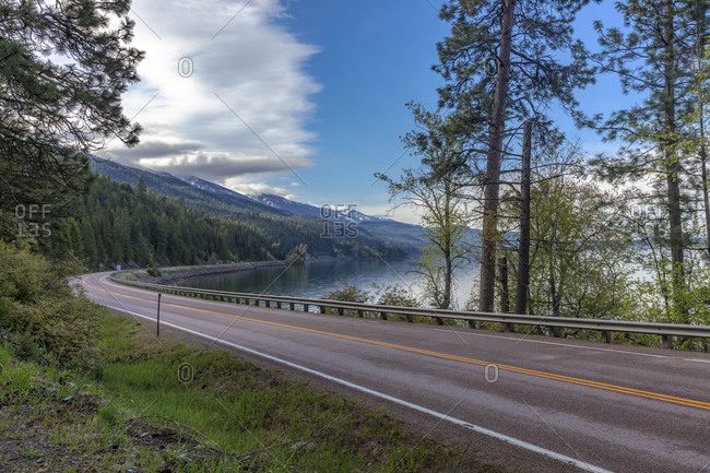 Highway 35 running along Flathead Lake on Skidoo Bay near Polson, Montana, USA