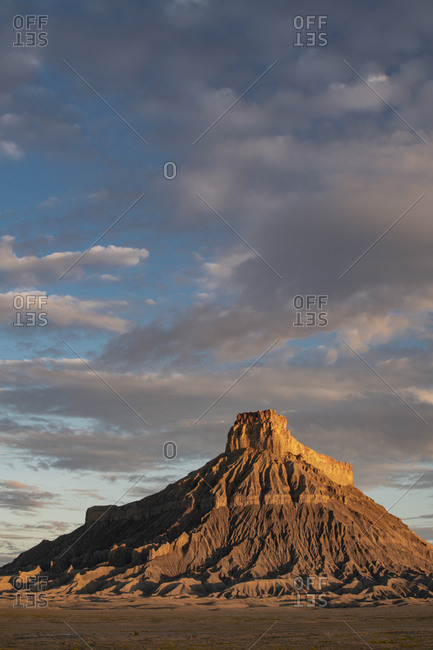 USA, Utah. Early morning clouds at Factory Butte, Upper Blue Hills.