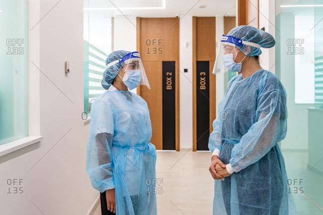 Female nurses discussing in corridor of dentist's clinic