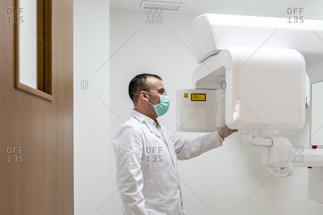 Male dentist working in laboratory at hospital