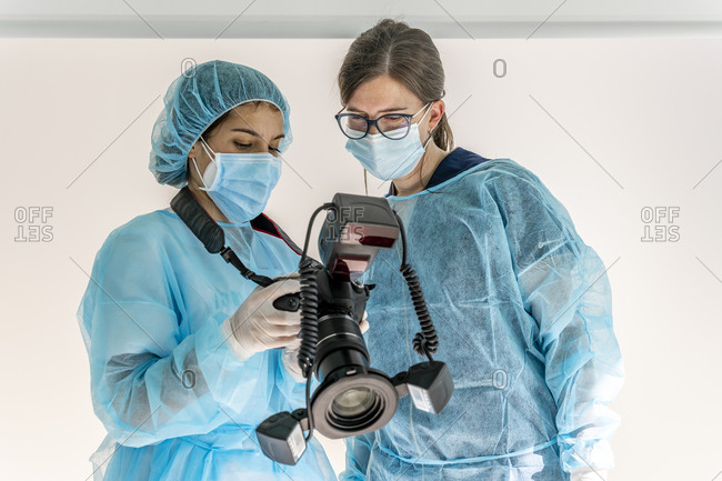 Female doctor and nurse looking at camera in dentist's clinic