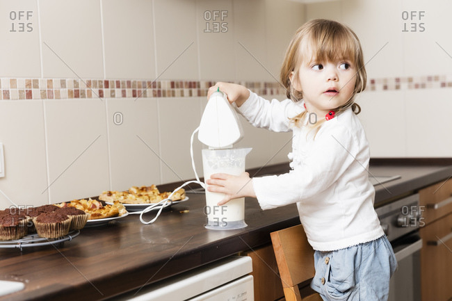 Girl whipping cream in kitchen
