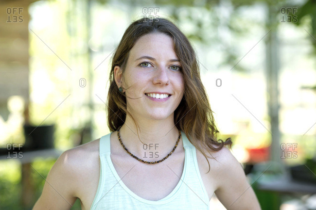 Close-up of smiling beautiful woman wearing necklace