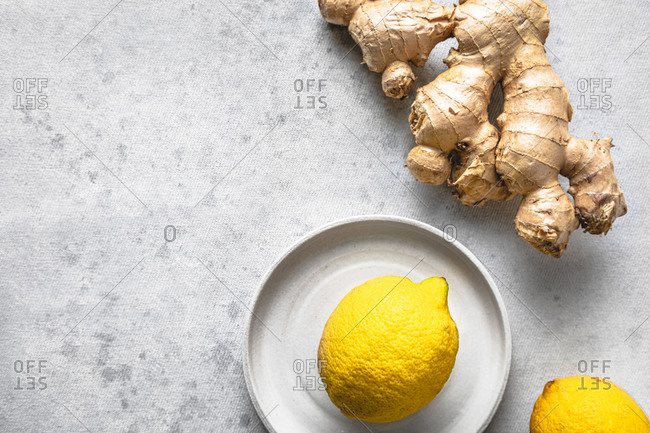 Studio shot of lemons and ginger root