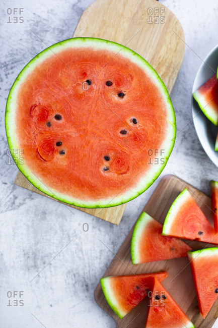 Chopped watermelon on chopping board