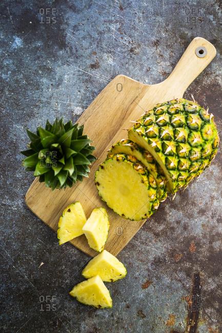 Chopped pineapple on chopping board