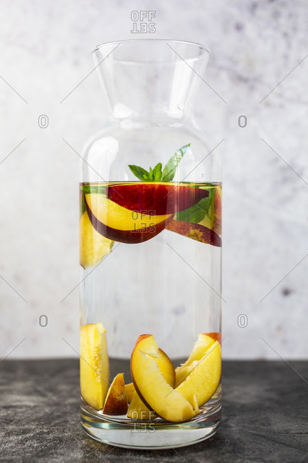 Detox water with peaches and mint