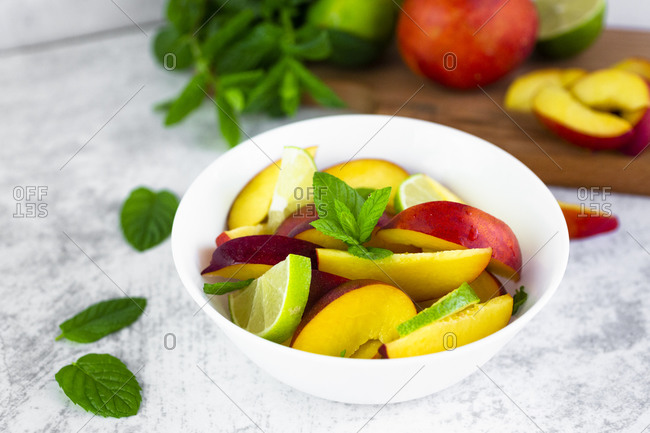 Fruit salad with peach- lime and mint