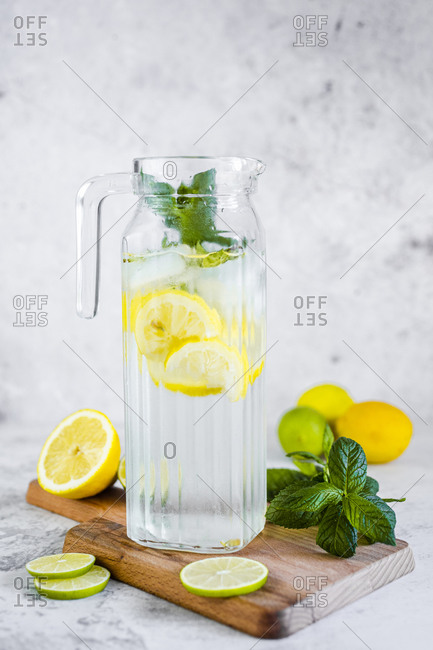 Detox water with lemon- lime and mint and ice cubes