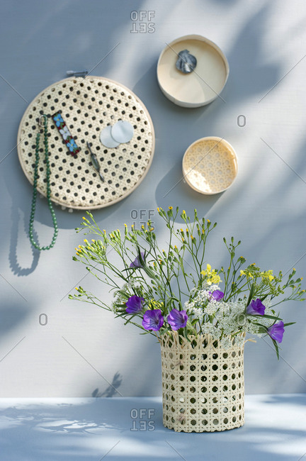 Wildflowers blooming in DIY vase made of embroidery frame