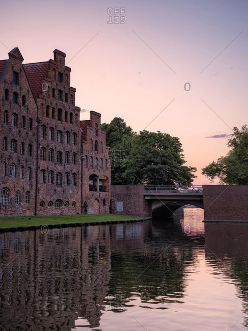 Germany- Schleswig-Holstein- Lubeck- Salzspeicher warehouses at dusk