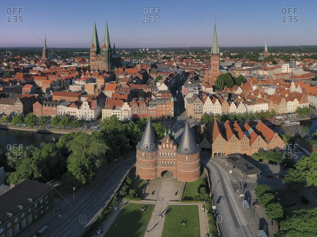 Germany- Schleswig-Holstein- Lubeck- Aerial view of Holsten Gate at dusk