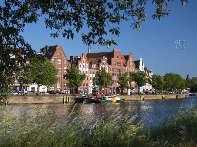 Germany- Schleswig-Holstein- Lubeck- Boat moored in front of Salzspeicher warehouses