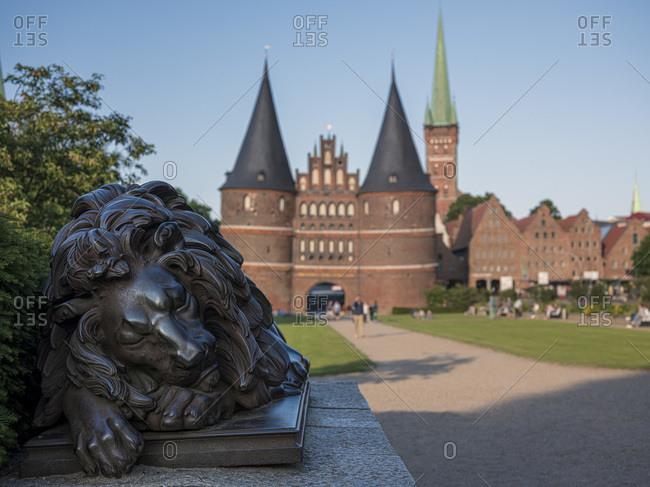 Germany- Schleswig-Holstein- Lubeck- Lion sculpture in front of Holsten Gate