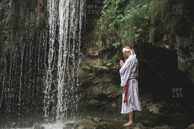 European yamabushi monk doing takigyo waterfall meditation