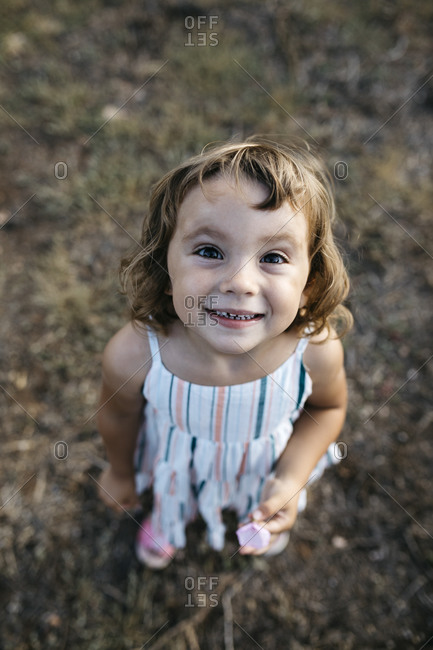 Close-up of smiling cute girl standing on land