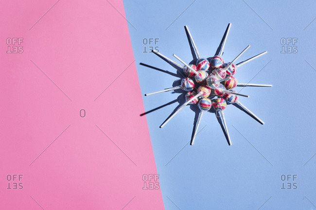 Lollipops arranged into shape of coronavirus cell
