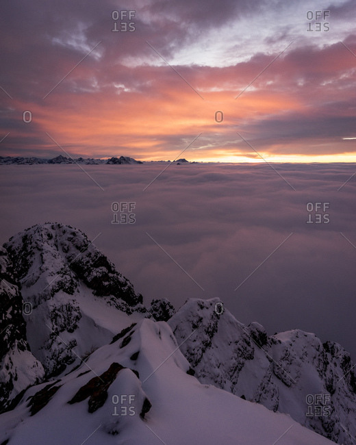 Snowcapped peak of Aggenstein mountain at moody sunset