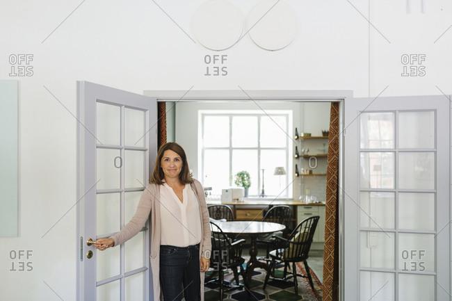 Woman standing in open door