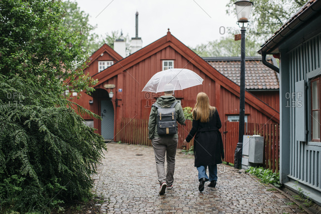 Couple walking together on a rainy day