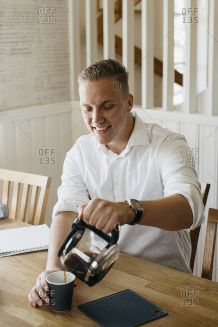 Man pouring coffee from coffee jug