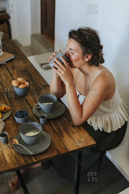 Woman having a cup of coffee