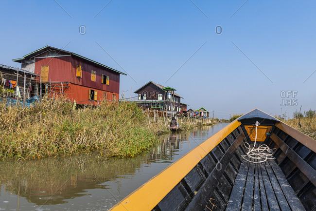 Myanmar- Shan state- Nampan- Stilt houses on Inle lake seen from rowboat