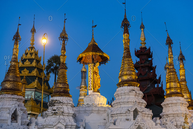 Myanmar- Yangon- Golden spires of Shwedagon pagoda at dusk