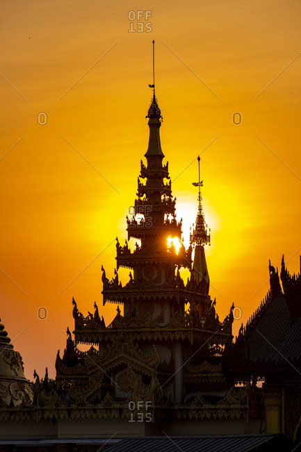 Myanmar- Yangon- Golden spires of Shwedagon pagoda at sunset