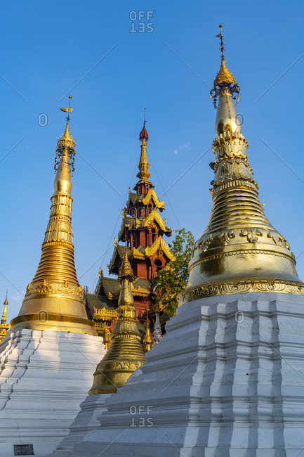 Myanmar- Yangon- Golden spires of Shwedagon pagoda against clear sky
