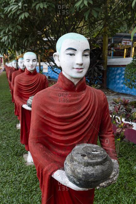 Myanmar- Kayin State- Hpa-an- Monk statues outside Kaw Ka Thawng Cave