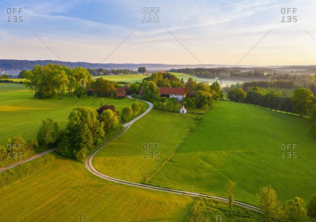 Germany- Bavaria- Upper Bavaria- Tolzer Land- near Eurasburg- Weiler- Fields at sunrise- aerial view