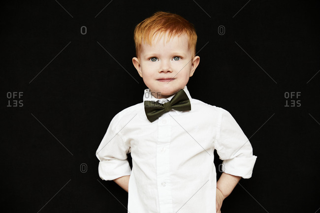 Boy wearing bow tie looking at camera
