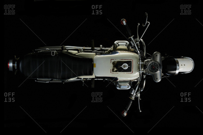Top view of vintage motorcycle with black background (Moto Guzzi V7/700)